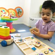 Child playing an educational puzzle